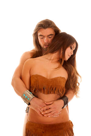 An American man holding on to his Native American woman, looking down. photo
