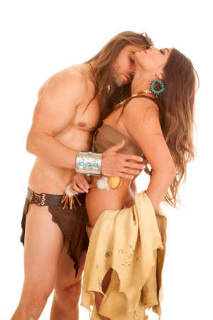 cherokee indian: A man getting ready to kiss the neck of an American Indian woman.