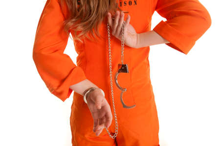 A woman from the back taking off handcuffs.