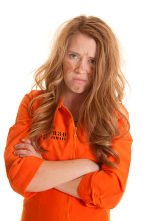 a woman in an orange jumpsuit looks very mad. Stock Photo - 24478718
