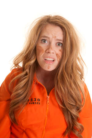 messed up: A woman in an orange jumpsuit is very messed up looking.
