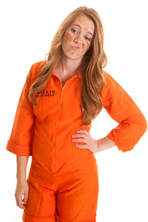 A woman in an orange jumpsuit with a funny expression on her face. Banco de Imagens