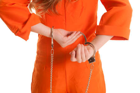 A womans back body taking of handcuffs.