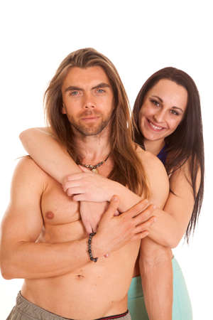 a woman holding on to her man with a smile. photo