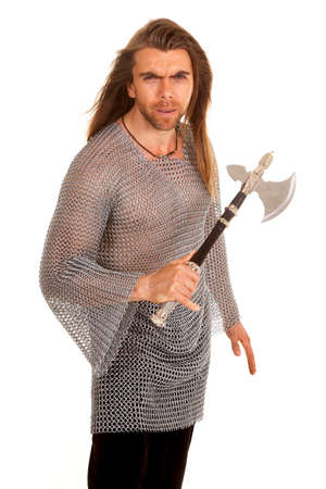 a man in his chain mail holding on to his axe. photo