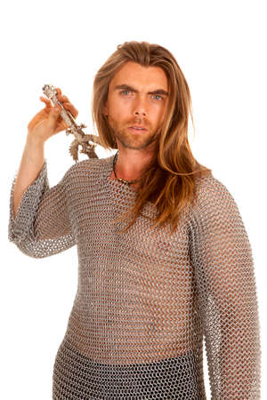 A man in his chain mail with his sword in hand. photo