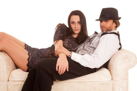 a woman and man on a couch cuddling. photo