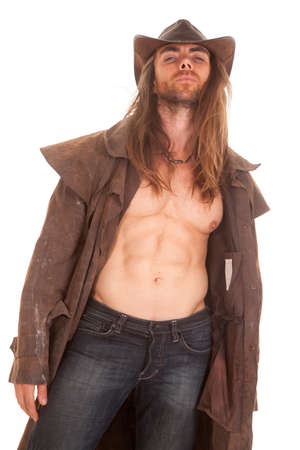 no shirt: a cowboy in his duster and hat with no shirt on. Stock Photo