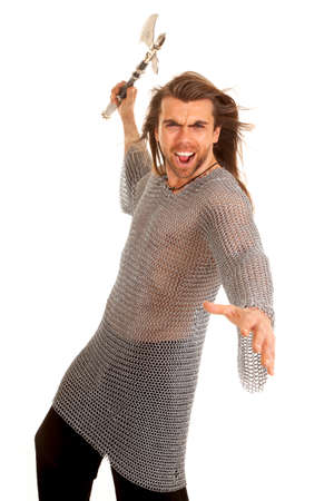 A man in medieval chain mail getting ready to battle with his axe. photo