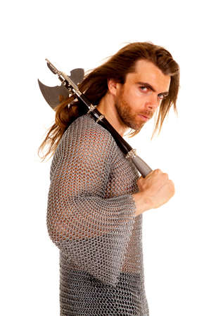 A man in his chain mail with a serious expression on his face holding onto his axe. photo