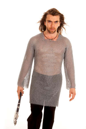 A man in his chain mail walking towards the camera with his axe in his hand. photo