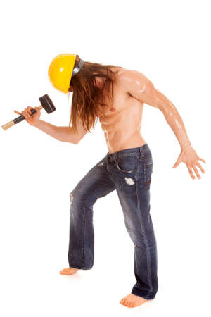 A man with his hammer and wearing his hard hat. photo