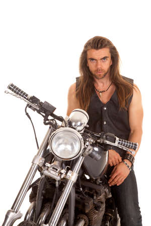 a man sitting on his motorcycle with a serious expression. Stock Photo