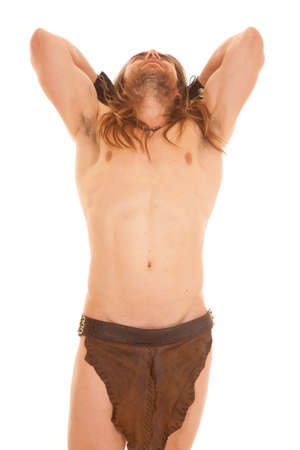 a man in his loin cloth with his head leaning back. photo