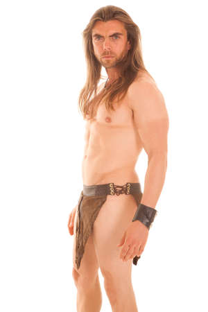 a man in his loin cloth with a serious expression on his face. photo