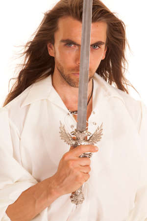 middleages: A man with his sword in front of his face. Stock Photo