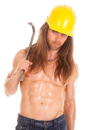 a man in his construction hat holding on to his crowbar with a serious expression. photo