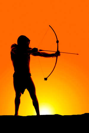 A silhouette of a man with his bow and arrow photo