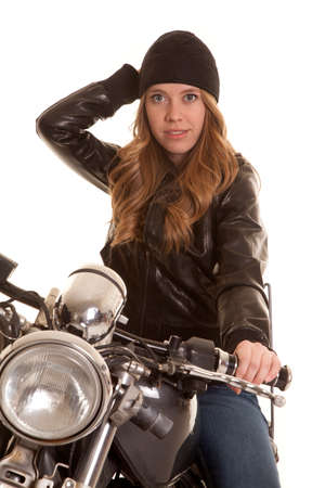 a woman on a motorcycle in her leather jacket and hat photo