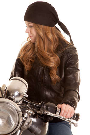 a woman in leather sitting on her motorcycle. photo