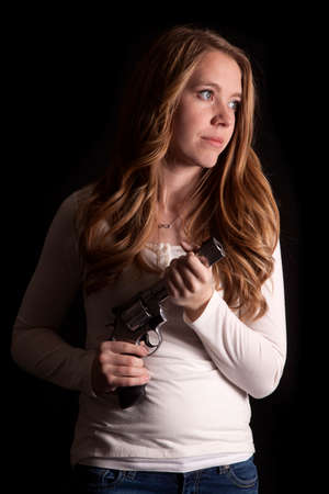 barrel pistol: A woman in low light holding on to her pistol