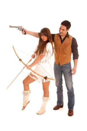 A cowboy is aiming a gun and an Indian is holding a bow and arrow. photo