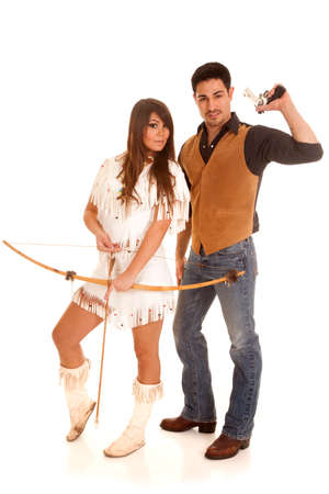 A cowboy is holding back his gun while an Indian holds her bow and arrow. photo