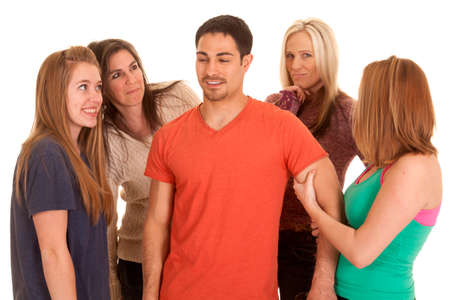 A man surrounded by business women and women dressed in fitness clothes. Stock Photo