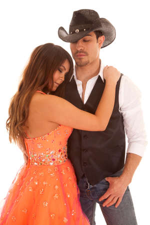 a woman holding on tight to her cowboy.