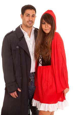 A man in his cloak holding on to his woman. She is dressed as little red.
