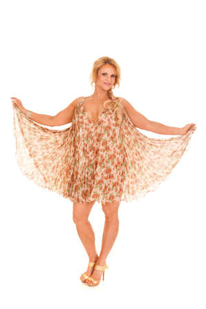 A woman in a see through dress holds out her skirt. Imagens