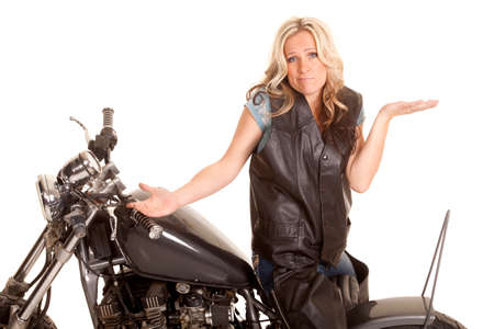 A woman in leather sitting backwards on a motorcycle. photo