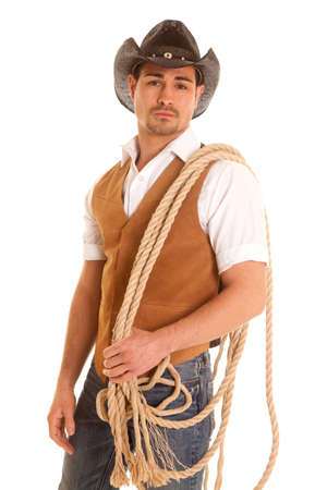 a cowboy with a serious expression on his face holding on to a rope.
