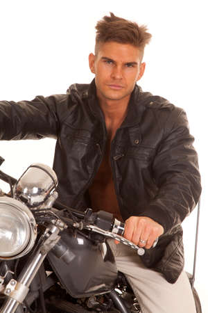 A man sitting on his motorcycle with a serious expression on his face. photo