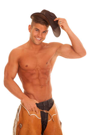 no shirt: a cowboy with his chaps and no shirt on with a happy expression on his face.