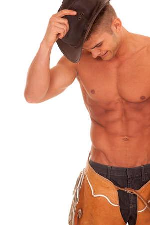 hombre con sombrero: Un vaquero sin camisa con su sombrero y chaparreras.