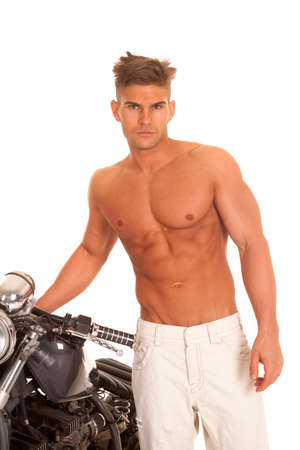 chrome man: a man without a shirt on standing by the motorcycle. Stock Photo