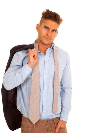 undoing: A man after a long day at work undoing his tie and holding on to his jacket. Stock Photo