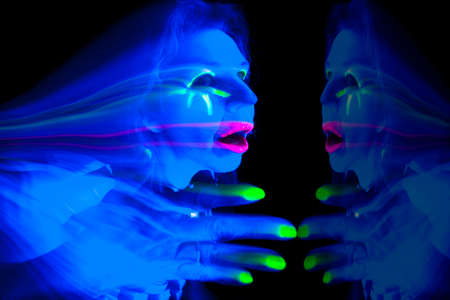 ultraviolet: A woman lit up with ultraviolet light looks like a ghost with a reflection.