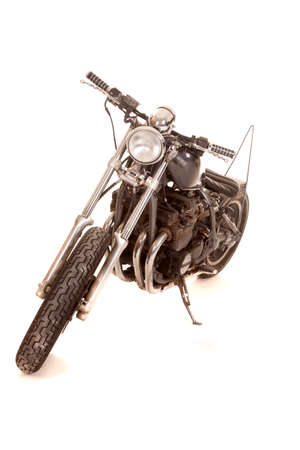 A motorcycle on a white background with nobody on it. photo