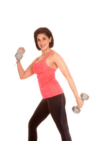 An older woman working out with weights trying to stay healthy. photo