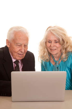 A older business woman and man working on a computer. photo