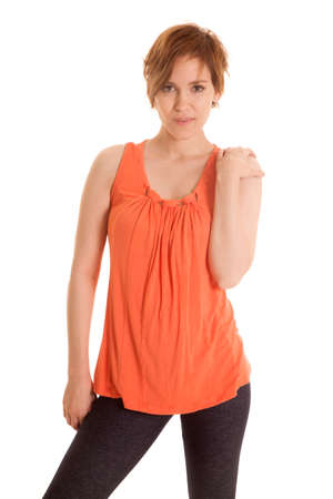 isolation tank: A Latin woman in an orange tank top standing looking.
