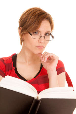 A Latin woman with glasses reading a book. photo