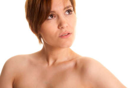 A woman with bare skin looking up serious. photo