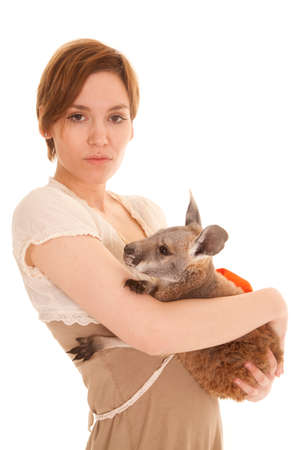 A Latin woman holding a kangaroo in her arms. photo