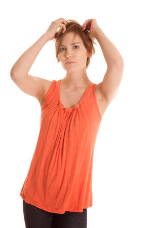 isolation tank: A Latin woman in an orange tank top standing. Stock Photo