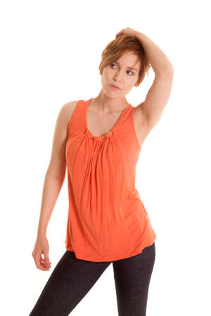 isolation tank: A Latin woman standing in an orange tank top.