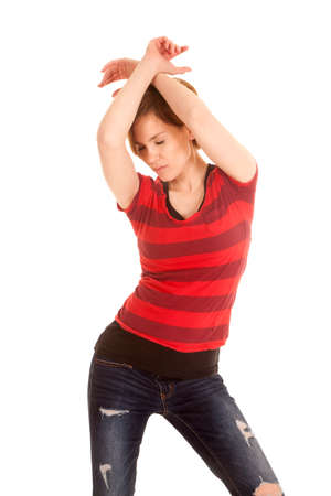 A Latin woman is standing and dancing with her eyes closed. photo