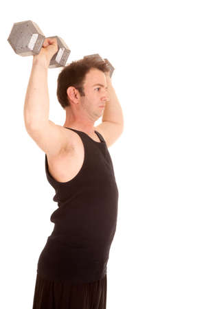 A man in a black tank top lifting big weights from the side. photo